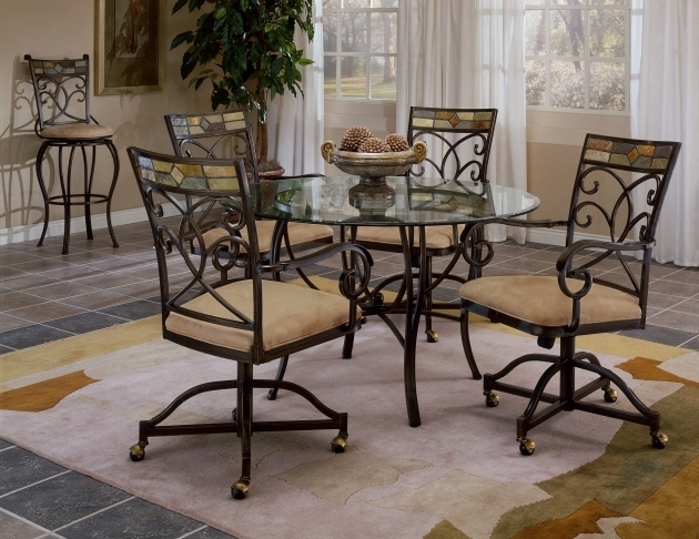Black Wrought Iron Kitchen Chairs With Wheels Having Cream Velvet Seat Cushion Images 22