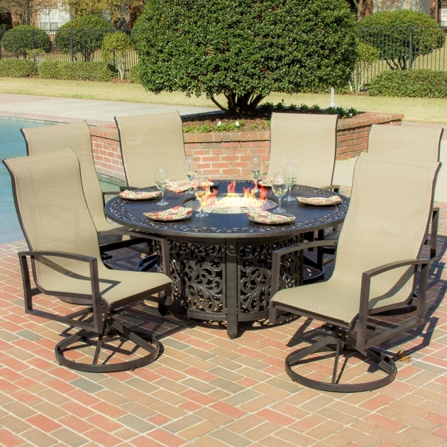 Outdoor swivel dining chairs ideas with dining table fire for Metal garden table and chairs