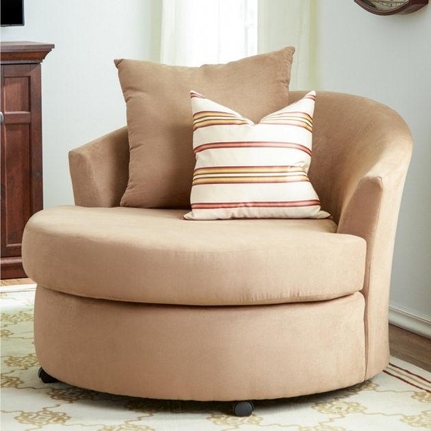 Declain Oversized Swivel Accent Chair In Sand Ashley