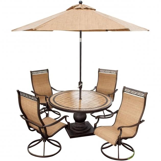 Monaco 5 Piece Swivel Rocker Dining Set With 9 Ft Table Umbrella Hanover Monaco Swivel Rocker Chair Pics 35